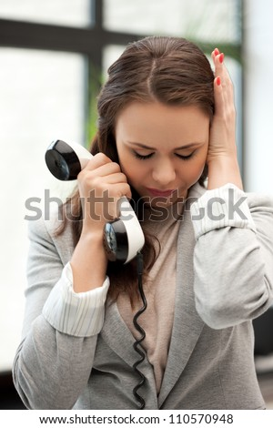 bright picture of sad businesswoman with phone - stock photo