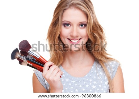bright picture of smiley woman with make-up brushes over white - stock photo