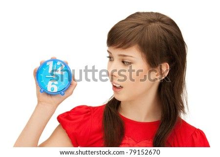 bright picture of teenage girl holding alarm clock