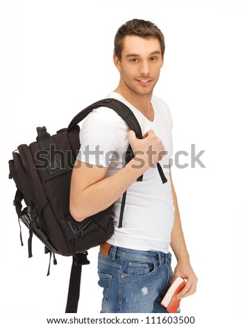 bright picture of travelling student with backpack and book - stock photo