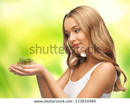 bright picture of woman with green grass on palms