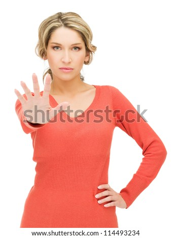 bright picture of young woman making stop gesture.. - stock photo