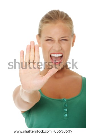 bright picture of young woman making stop gesture. Isolated on white background. - stock photo
