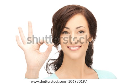 bright picture of young woman showing ok sign