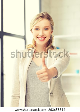 bright picture of young woman with thumbs up - stock photo