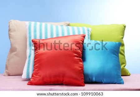 bright pillows on blue background