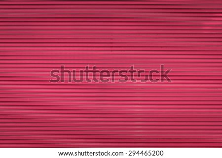 Bright ping metal sliding door with key hole, taken on a cloudy day. - stock photo