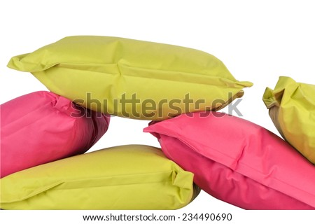 bright pink and green pillows isolated on white - stock photo