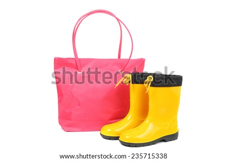 bright pink bag and yellow rubber shoes - stock photo