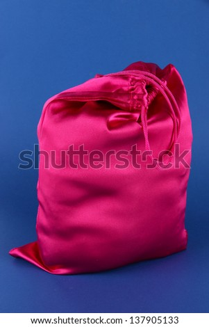 Bright pink bag on blue background