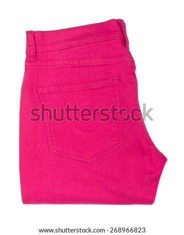 bright pink jeans folded on isolated white background