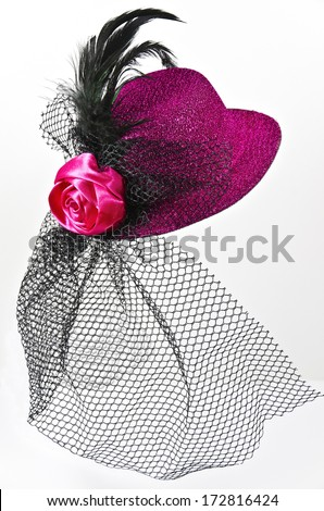 Bright pink  lady's hat with a black veil isolated on white - a carnival costume accessory - stock photo