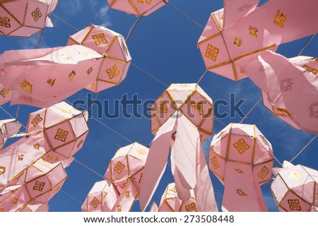 Bright pink paper lanterns decorate a Buddhist temple in Chiang Mai, Thailand - stock photo