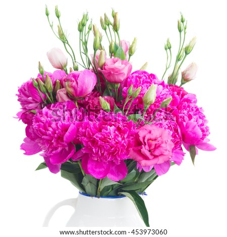 Bright pink peony and eustoma flowers bouquet close up isolated on white background - stock photo