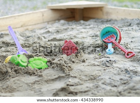 Bright plastic children toys in sandpit or on a beach