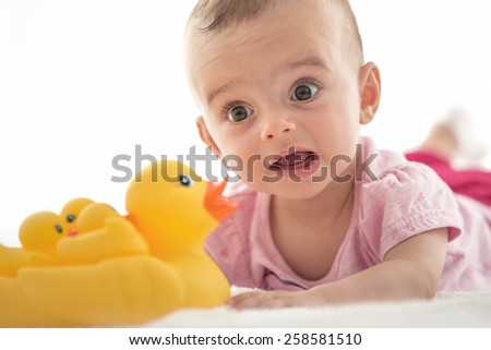 Bright portrait of adorable baby on white - stock photo