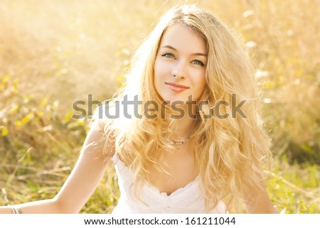 Bright Portrait of Happy Woman at Summer Field - stock photo