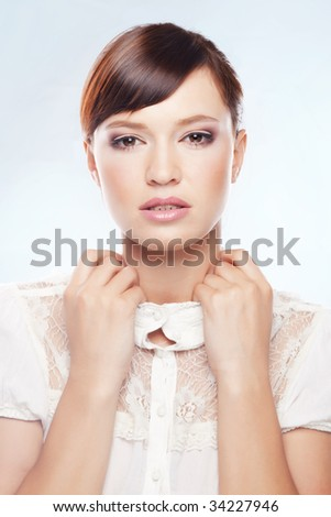 Bright portrait of young beautiful woman over light blue