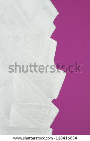Bright purple wall painted in white with paint roller. Brush stroke texture. - stock photo
