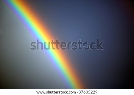 bright rainbow across the heavens showing all the colors