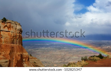 Bright rainbow over Grand Junction  Colorado from National Monument Park