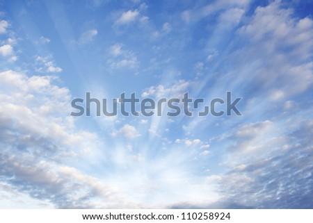 Bright rays of light in sky - stock photo