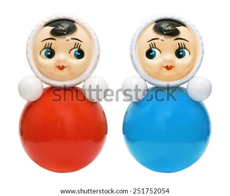 Bright red and blue roly-poly toy on the white - stock photo