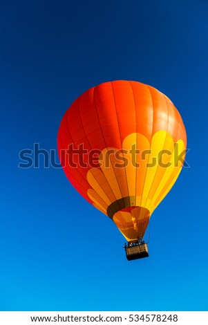 Bright red and orange hot Air Balloon in the sky