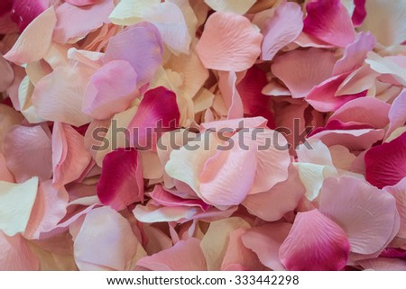 Bright red and pink flowers decorate a wedding ceremony. - stock photo