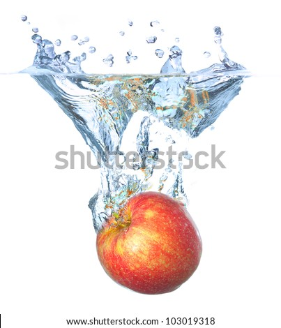 Bright red apple and water splash. Tasty and healthy food - stock photo