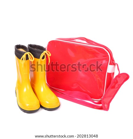 bright red bag and yellow rubber shoes - stock photo