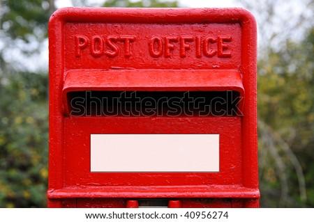 Bright red British post box - stock photo