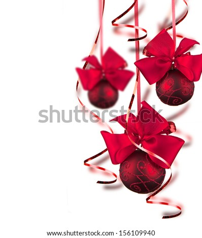 Bright red Christmas tree balls with curly ribbons isolated on the white background  - stock photo