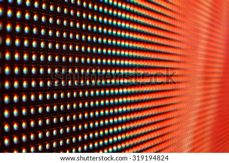 Bright red colored LED smd screen - grid extreme macro background - stock photo