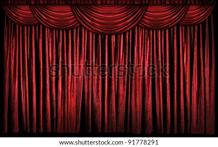 Bright red curtains on stage with lights and shadows