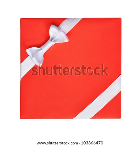 Bright red gift with a white ribbon bow, isolated on white - stock photo