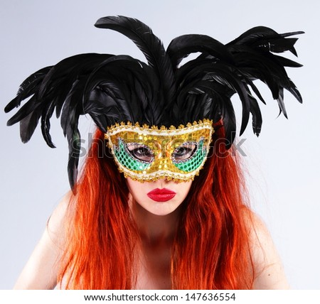 Bright red hair and colored mask - stock photo