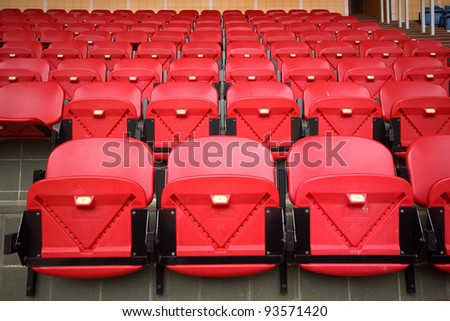 Bright red stadium seats - stock photo