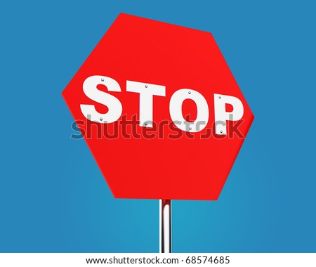 bright red traffic sign STOP against blue sky - stock photo