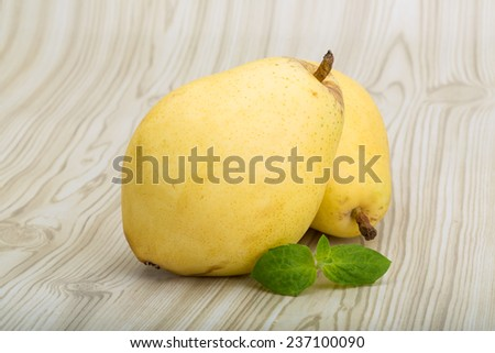 Bright ripe Yellow pears with mint leaves