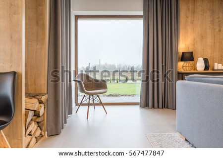bright room with big window and armchair