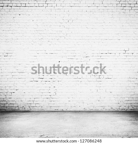 Bright room with tile floor and brick white wall background - stock photo