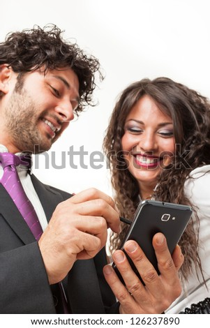 Bright shot of a gourgeous business couple using a smartphone over a white background