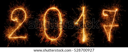 Bright sign sparklers 2017 isolated on the black background