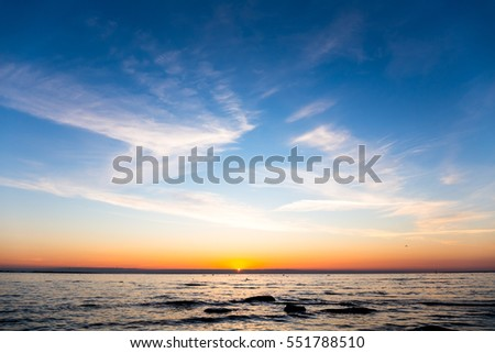 Bright sky and water at sunset over Baltic sea of Tallinn, Estonia