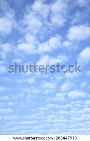 Bright sky with clouds - vertical background - stock photo