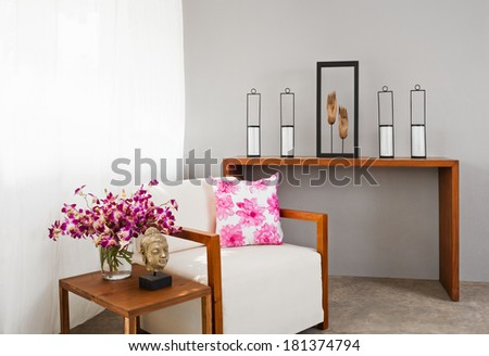 Bright sofa seat in luxury interior decoration with orchids - stock photo