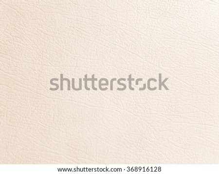 bright soft orange/beige color leather background:wrinkle of genuine skin backdrop:crinkle of pure cowskin wallpaper for design,decorate,banner,template:cropped image. - stock photo