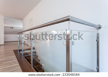 Bright space - a closeup of a silver glass barrier - stock photo