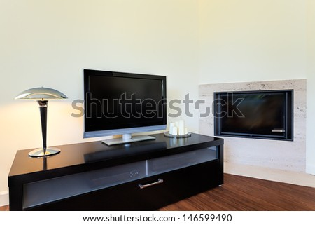 Bright space - a living room corner with a tv set and a fireplace - stock photo